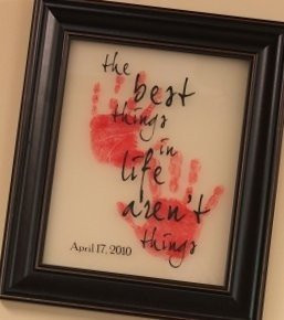 ... the quote in vinyl on the wall with each kids handprint on a canvas