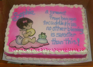pink baby shower cake with picture of baby sitting on a blanket next ...