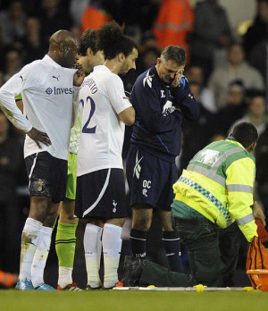 The medical team tend to Bolton Wanderers' Fabrice Muamba who