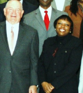 Clovia Hamilton to the right of Georgia's Governor Sonny Perdue.