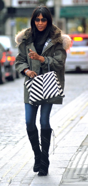 Naomi Campbell walks in London with her striped Fendi Fall/Winter 2014 ...