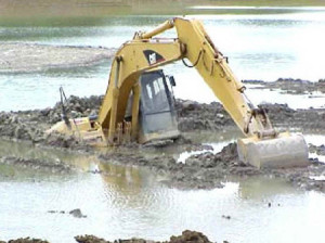 excavator sunk in mud