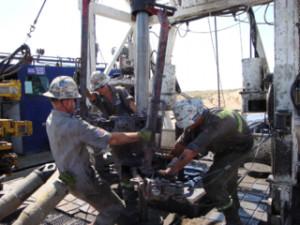 Roughnecks on a drilling rig.