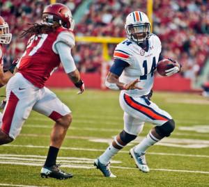 Auburn quarterback Nick Marshall (14) is pursued by Arkansas safety ...