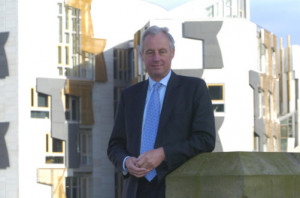 Tim Yeo pictured outside the Scottish Parliament says he is