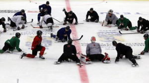 Team Canada players take a knee during practice at the IIHF World ...