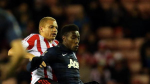 Sunderland's Wes Brown, left, vies for the ball with Manchester United ...