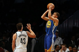 ... warriors point guard stephen curry 30 shoots over brooklyn nets power