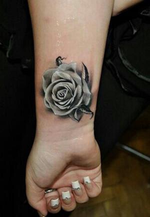 Dandelion tattoo on wrist