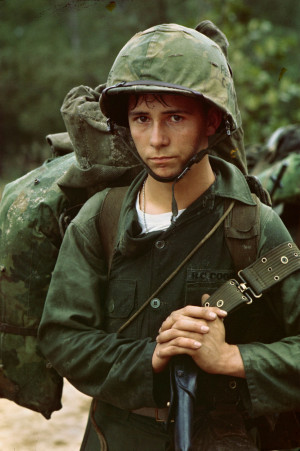 Da Nang, Vietnam...A young Marine private waits on the beach during ...