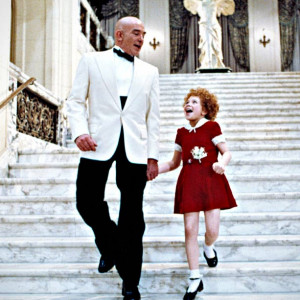 It's hard to resist the exuberance of little orphan Annie. Daddy ...