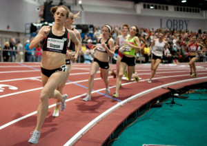 field on her way toward winning the mile run at the USA Indoor Track ...