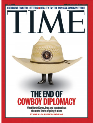 Cowboy hat, bearing presidential seal, with two small feet emerging