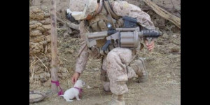 Soldier with tiny doggy