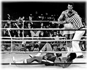 George, that the best you got? Muhammad Ali stands over George Foreman ...
