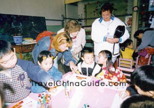 Foreigners play with the children