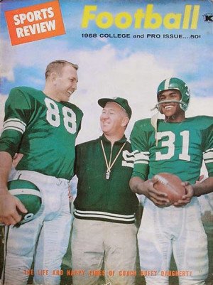 The great Duffy Daugherty with two Spartans.