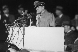 MacArthur addresses an audience of 50,000 at Soldier Field , Chicago ...