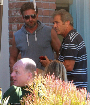 He's been going great guns! Mel Gibson shows off his muscular arms ...