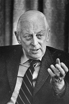 Alistair Cooke, head-and-shoulders portrait, facing front, gesturing ...