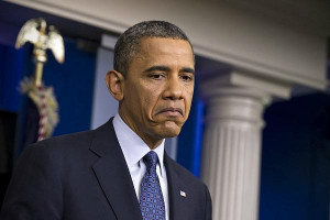 President Barack Obama pauses while talkig about the economy, Friday ...