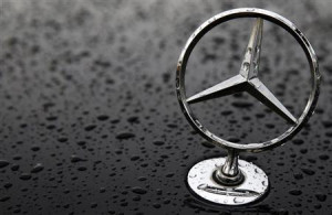 The emblem of German car manufacturer Mercedes-Benz, a subsidiary of ...